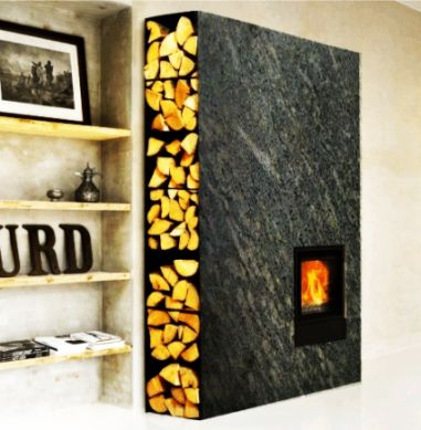 A stylish modern soapstone stove, custom built to fit the space. Soapstone is exceptionally good at storing and radiating heat.