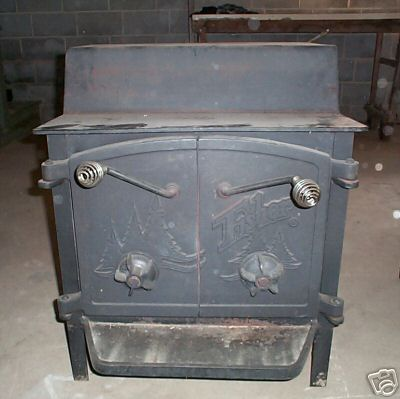 The double door Fisher Fireplace; this one was restored after years of neglect in an outbuilding.