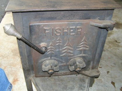 The classic cast Fisher stove door, no glass in those days so no view of the fire.