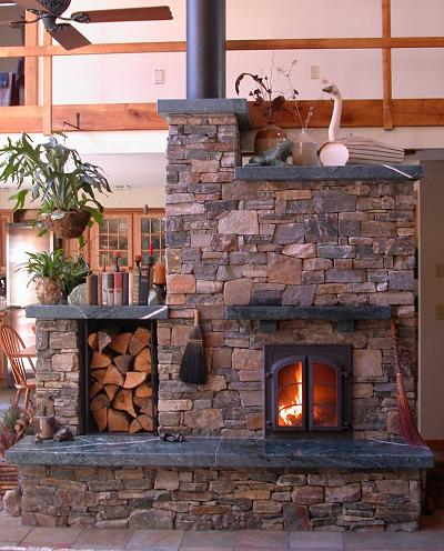 Choose an outer skin that suits your home decor style - here rough stones clad a masonry stove