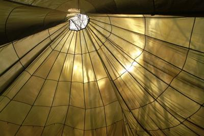 The Parachute is suspended by the center where there is a hole - ideal for letting smoke out!